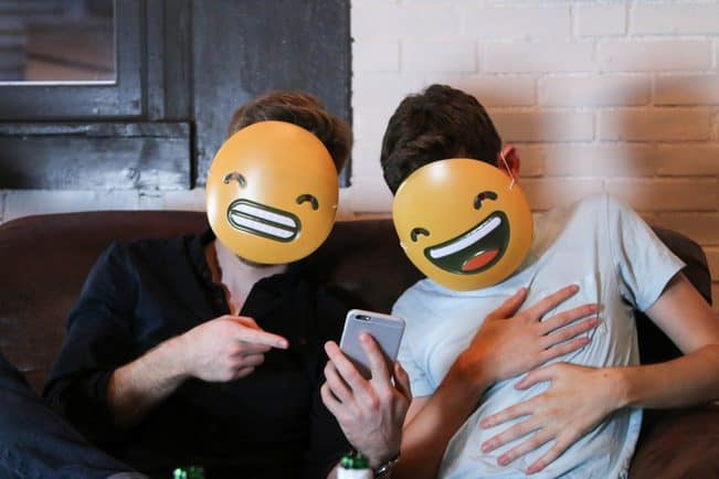 emoji-grin-and-laughing-with-phone